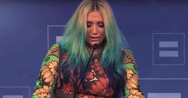 Kesha accepting her LGBT Visibility Award