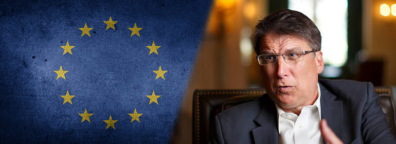 EU flag on left with Pat McCrory (North Carolina's Governor, and defender of HB2) on right
