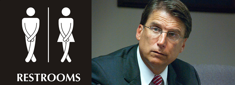 Pat McCrory, North Carolina Governor, beside a unisex bathroom sign for transgender people