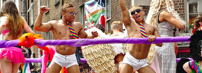 Two men dancing on a float for Dublin pride