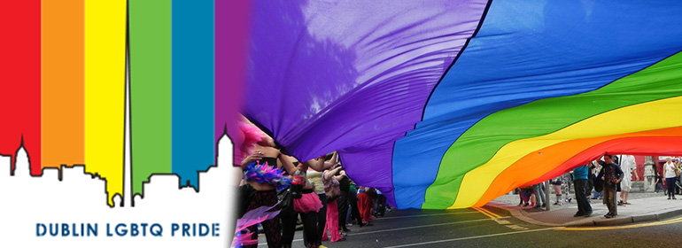 Dublin Pride's rainbow logo on the left in and rainbow coloured sheet of material on the right at Dublin pride as part of the GCN Dublin Pride Guide 2016