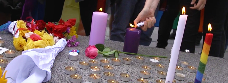 flowers and rainbow candles at the dublin vigil for Orlando
