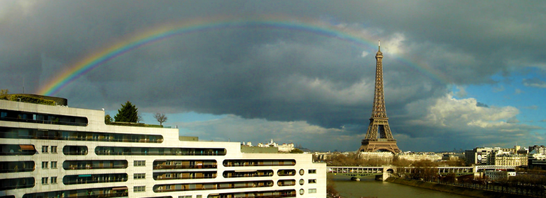 Paris skyline with the eiffel tower and a rainbow, as French police shorten pride route to make it more secure