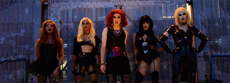Veda and other drag queens in the video for Blowing You Kisses