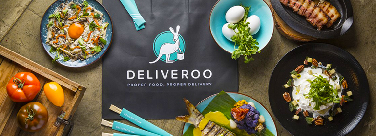 food on a table around a Deliveroo bag - food that you could eat with a Deliveroo Voucher which is being given away in this competition