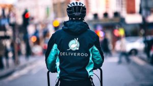 Deliveroo driver on their way with food that somebody paid for with their deliveroo voucher