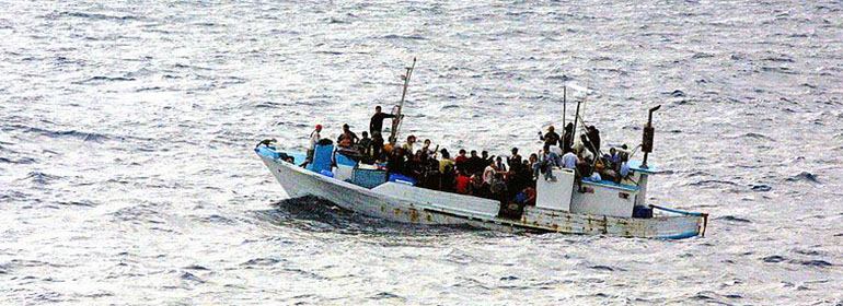 Gay refugee refused asylum, like these refugees on a rusty boat in the ocean