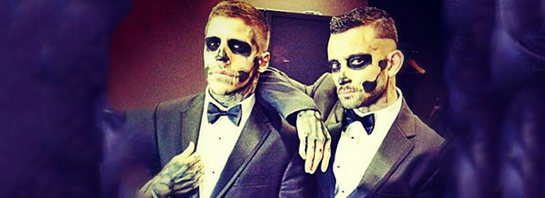 Two skeletons dressed up in suits which is one of the halloween costumes for gay men