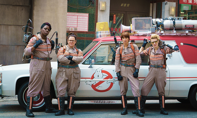 Ghostbusters from this year's movie in suits, which is a great Halloween costume for lesbians