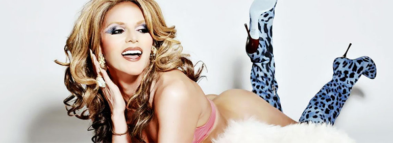 Willam belli lying dow with blue high heeled boots - she's one of today's Cuppán Gay