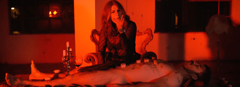 Sarah Byrne singing for Faune's new track 'Waiting' with a naked man covered in sushi
