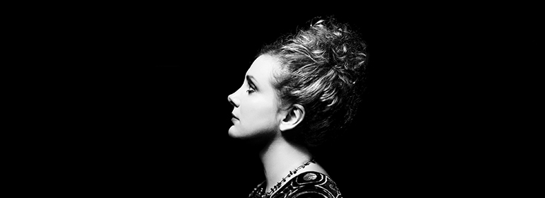 Christine Bovill as Piaf in her show in the Olympia theatre