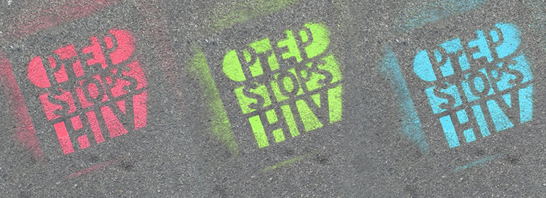 Act Up Dublin spray painted PrEP Stops HIV on the ground in Red Green and Blue