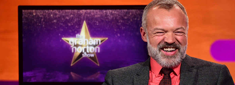 Graham Norton laughing with a beard