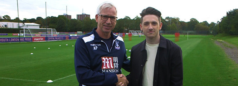 Playing straight presenter stephen byrne shaking someone's hand as he's interviewing people about homophobia in football