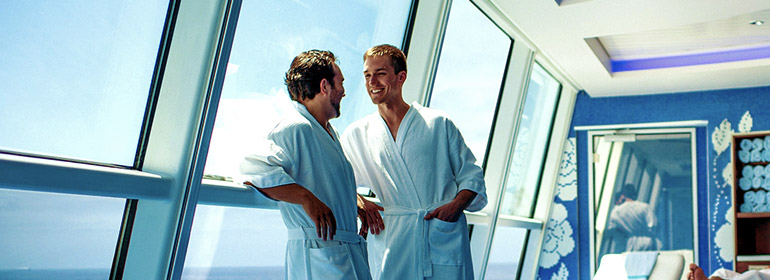 Two men standing in white bathrobes on a Celebrity Cruises cruise ship