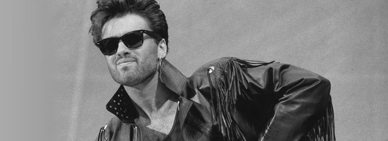 George Michael, who recently passed away at the age of 53, in a black leather jacket and sunglasses