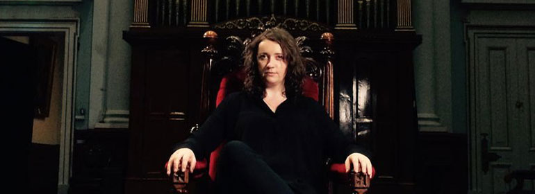 Ana Mullally, who has been appointed as chair of a youth LGBT strategy group, sitting in a grand chair