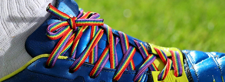 Rainbow laces on a soccer player's boot which is one of the stories in today's cuppán gay