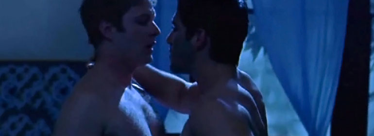 A still image of two men about to kiss at night time from the film head on which is being shown by Dublin Film Qlub