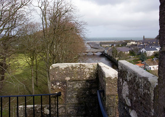 The view from atop a castle looking over a river at a bridge and trees at one of the Irish Landmark Trust venues - the same Irish Landmark Trust who has a Valentine's Giveaway