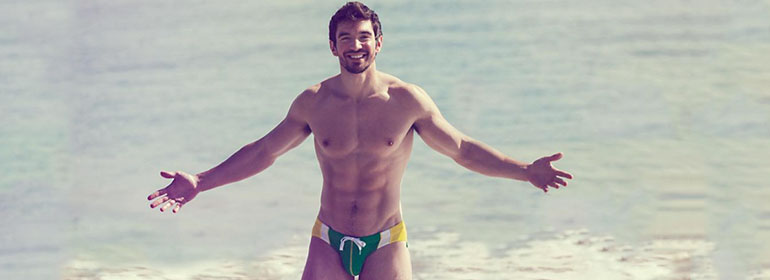Steve Grand, who is featured in today's Cuppán Gay, standing in swimwear in the sea