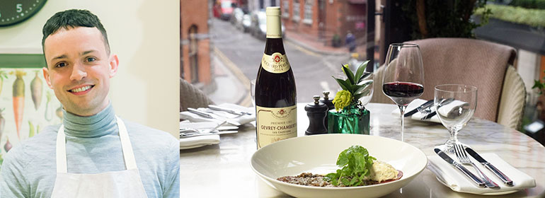James Kavanagh (left) who wrote a review about Wilde restaurant (pictured right with food and wine on a table overlooking dublin.