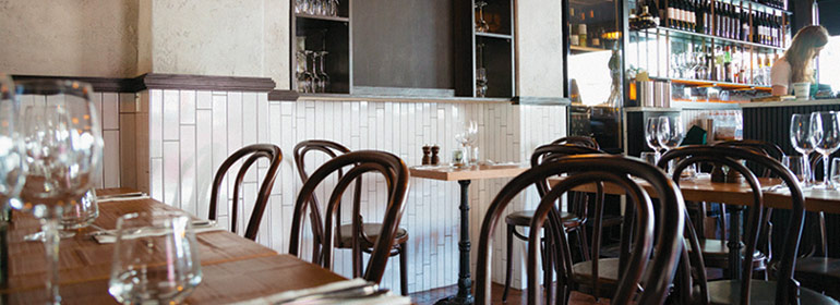 The Italian restaurant Cirillo's with wooden tables and chairs