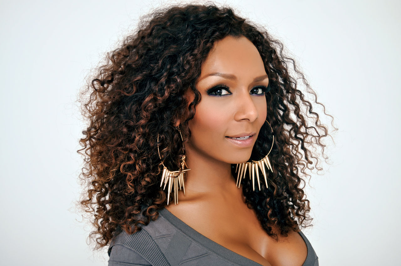Janet Mock, a black woman with curly hair and earrings, one of the role models and trans advocates that trans opera singer Lucia Lucas highlighted