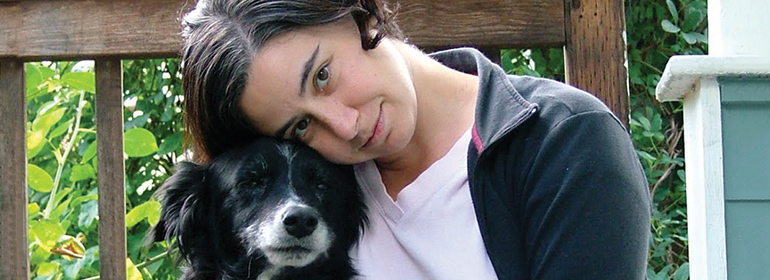Laurie Frankel, the author of this is how it always is, with a black and white dog