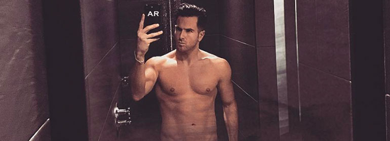 Aaron Renfree taking a topless selfie in the shower which is one of the stories in today's Cuppán Gay