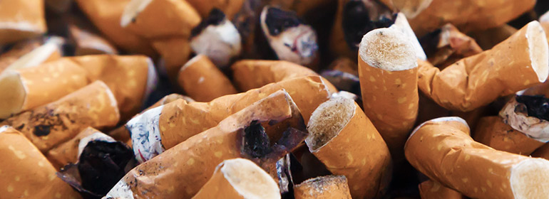 Andy Kane talks new years resolutions, like giving up the cigarette butts pictured here