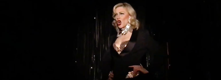 Cate Blanchett singing in a black and gold Givenchy outfit which is one of the stories in today's Cuppán Gay