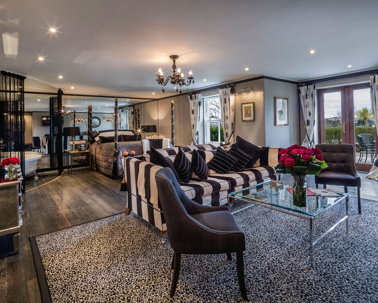 An interior shot of the lodge at ashford castle where if you book a wedding, you could win a luxury cruise to the value of e10000 with chairs and couches