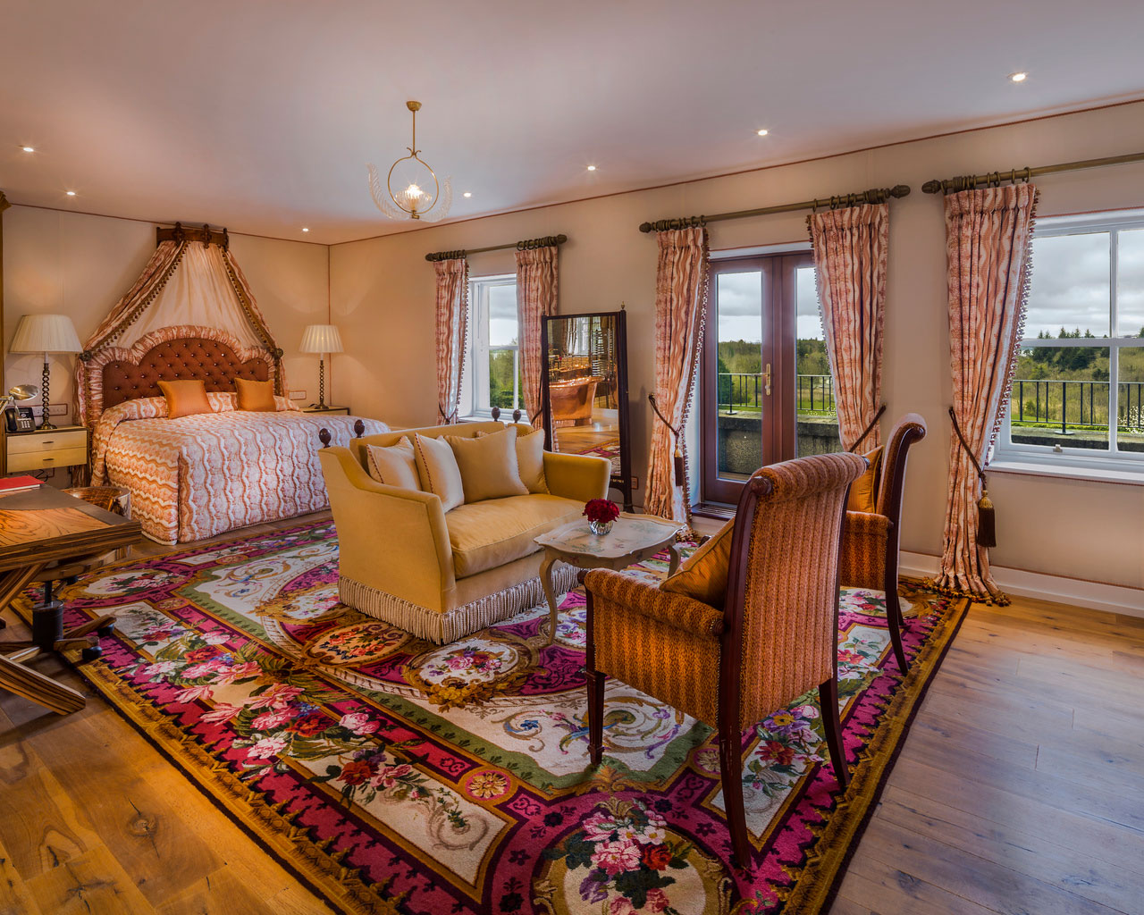 An interior shot of the lodge at ashford castle where if you book a wedding, you could win a luxury cruise to the value of e10000 with chairs, a couch and a bed
