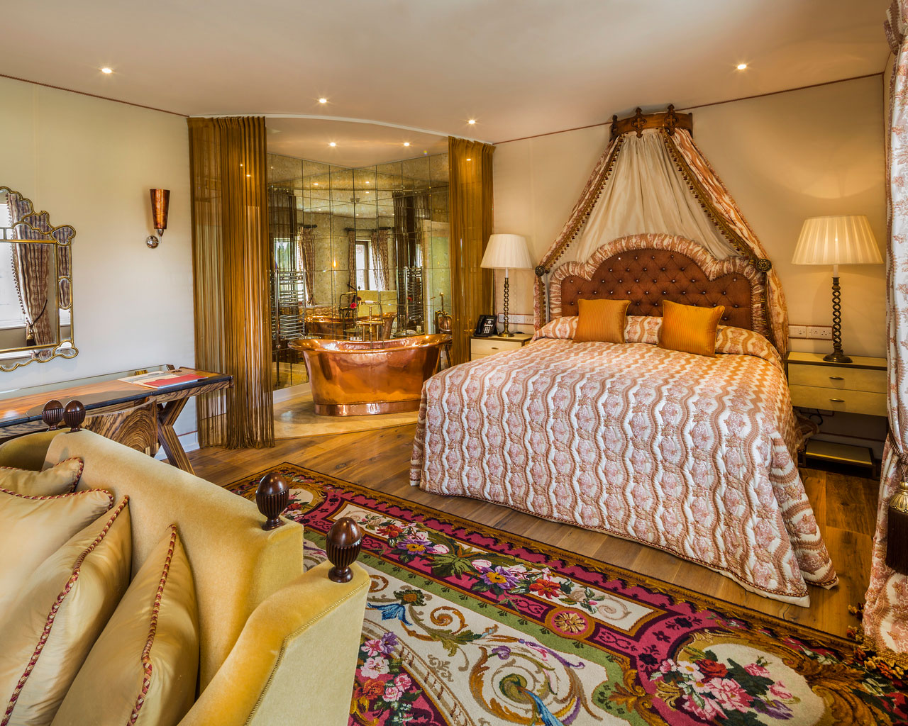 An interior shot of the lodge at ashford castle where if you book a wedding, you could win a luxury cruise to the value of e10000 with a bed, rugs and lamps
