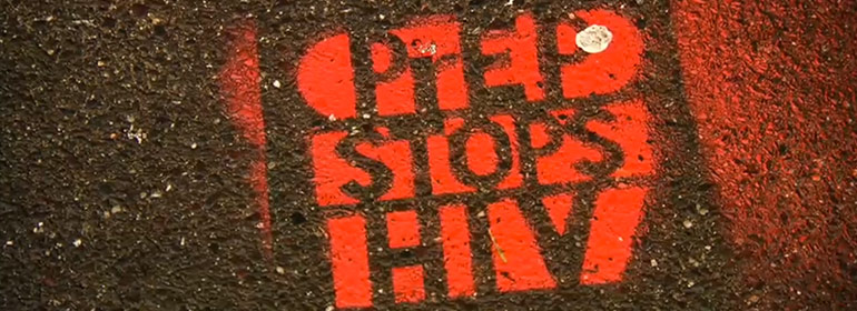 A stencilled graffiti work that reads PrEP stops HIV, in red