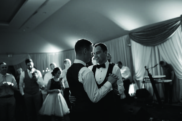 The two grooms dancing in black and white from Andrew and Thomas' Real Weddings article