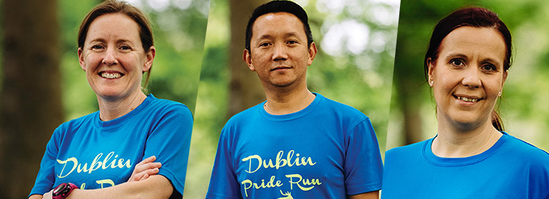 Three of the Dublin Front Runners smiling and wearing a blue Dublin Pride Run T shirt
