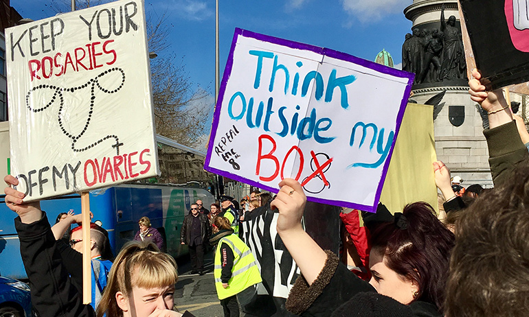 A Strike 4 Repeal sign saying Think outside my box