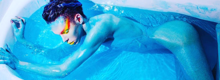 A blue alien in a bathtub which is one of the stories in today's Cuppán Gay