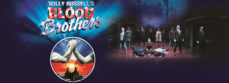 The poster for Blood Brothers with actors standing on a stage to the right and two hands clasping on the left