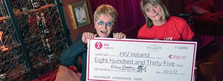 Mr Pussy presenting HIV Ireland with a giant cheque for €835