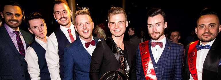 The winner and other contestants of Mr Gay Ireland 2017 in suits with smiles on their faces