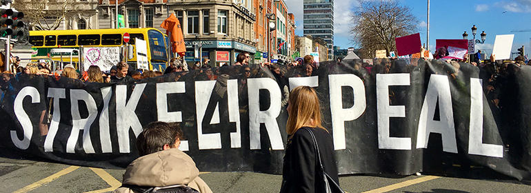 A Strike 4 Repeal sign saying Strike 4 Repeal