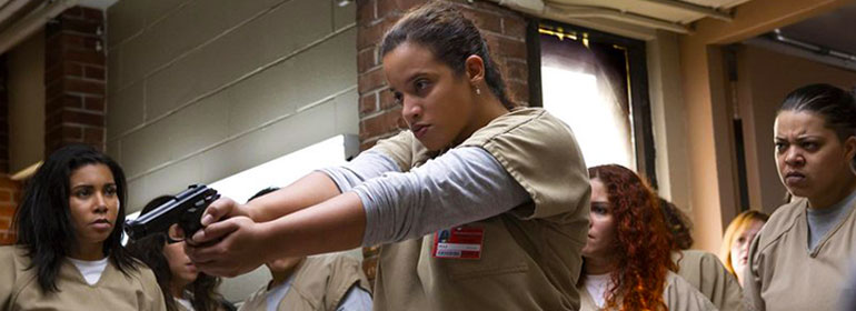 Daya holding a gun in the new season of Orange Is The New Black