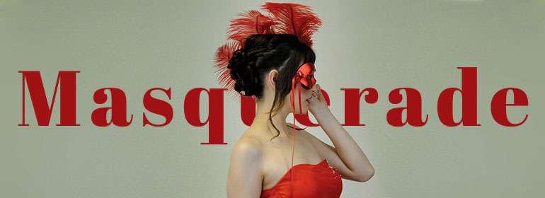 A woman in a red dress with a red masquerade ball mask