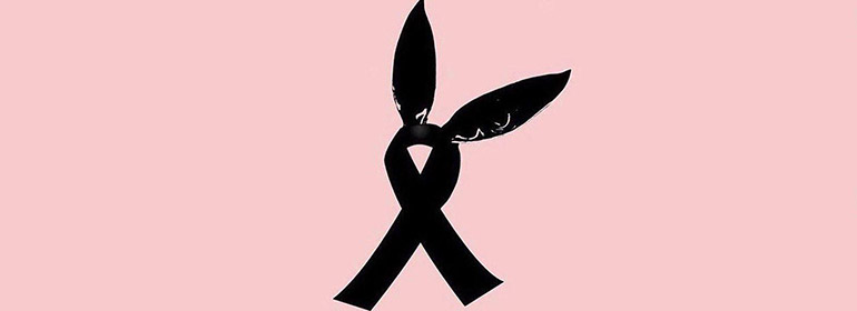 a pair of bunny ears atop a black ribbon on a pink background to represent those killed and injured at the Ariana Grande concert in Manchester Arena