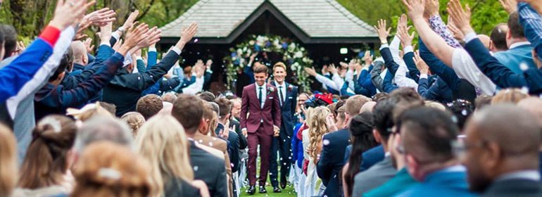 Tom Daley and Dustin Lance Black walking down the aisle on their wedding day which is one of the stories in Today's Cuppán Gay
