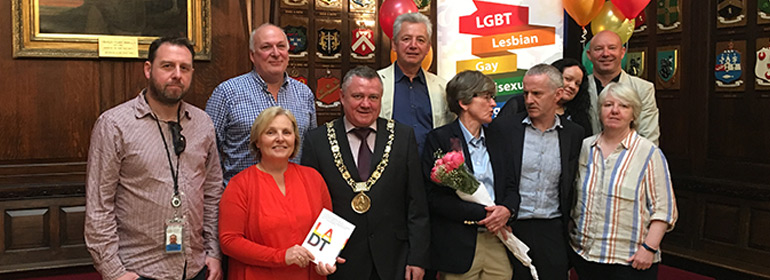 Dublin City Council members who are launching their LGBT inclusion strategy in Mansion house with balloons and a white sign behind them